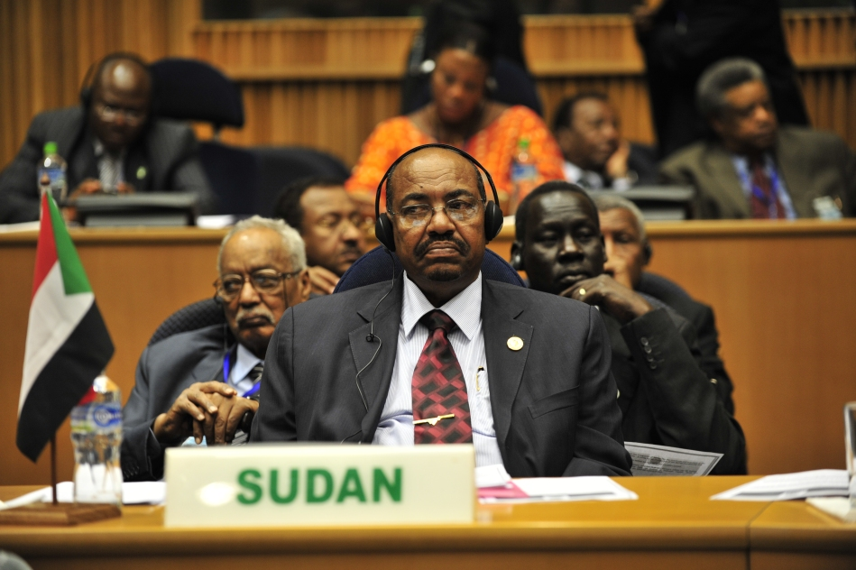 Omar Hassan Ahmad al-Bashir, president of Sudan, listens to translated remarks during the opening of the 20th session of The New Partership for Africa's Development (NEPAD)