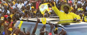 Uganda's President Yoweri Museven waves to his supporters.	(Reuters/James Akena)